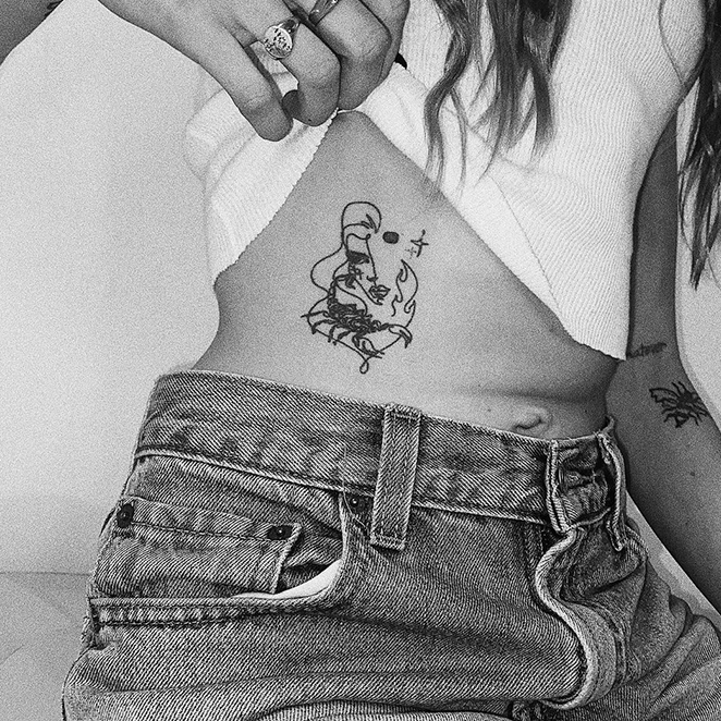 HOW TATTOOS AND BODY ART SPEAK TO OUR SOULS